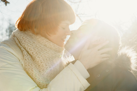 backgroung: Young couple kissing on sunlight backgroung