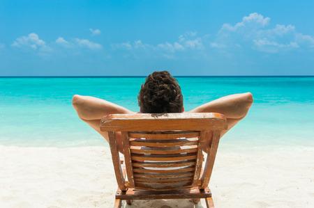 maldives island: Man relaxing on beach, ocean view, Maldives island Stock Photo