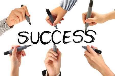 many hands: Many hands writing  success word Stock Photo