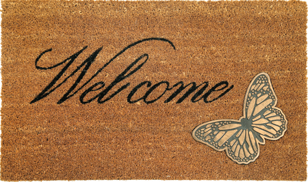 Beautiful welcome peach color coir doormat with Butterfly Banco de Imagens
