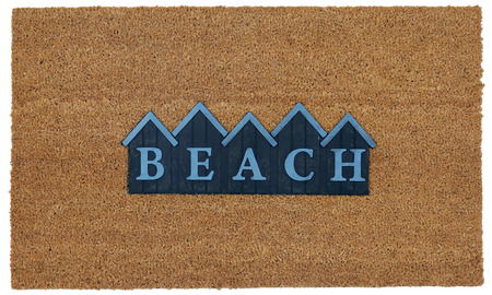 Beautiful beige and blue zute  coir Outdoor Door mat with BEACH text in mountain style 写真素材