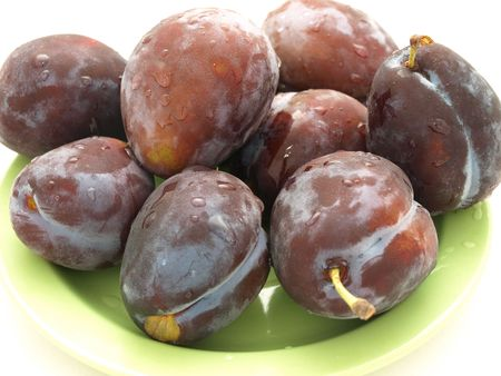 plums on the green plate Stock Photo