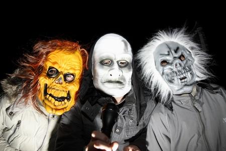 Children in halloween masks celebrates Halloween. Editorial