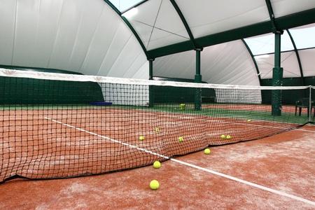 Tennis balls on the indoor tennis court.
