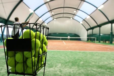 Tennis balls on the indoor tennis court. photo
