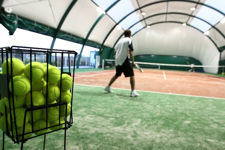 Tennis player on the indoor court