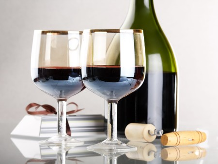 Glass of red wine with glass and bottle Stock Photo - 4561739