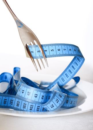 Fork and measuring tape photo