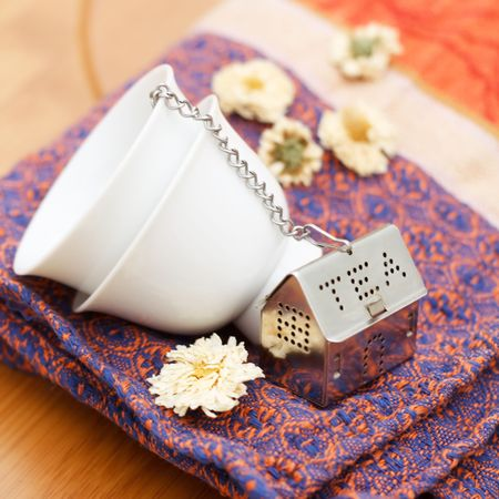 infuser: Tea Strainer with Stacked Small Cups