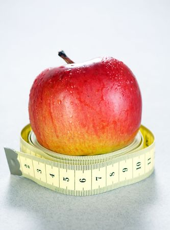 good cholesterol: Apple and a measure tape