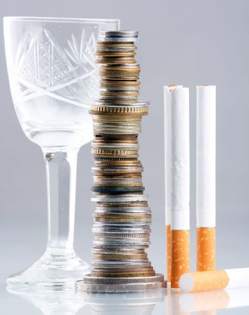 cigarettes and money on table photo