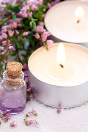 Lavender spa with essential oil and candles photo
