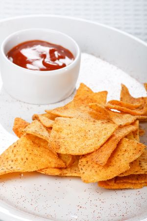 tortilla chips with hot salsa mexicana   photo