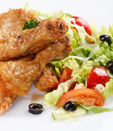 Roasted chicken legs with salad photo