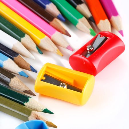 sharpeners: crayons and sharpeners on white background