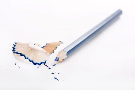 sharpenings:   Sharpened pencil and wood shavings  Stock Photo