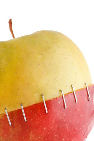 mismatch: The creative apple combined from two half of red and yellow color  Stock Photo