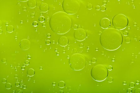 oil drops background with big and small drops photo