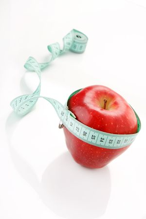 Apple and a measure tape Stock Photo - 6736923