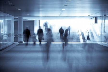 zoom earth:  motion blurred of people walking in subway  Stock Photo