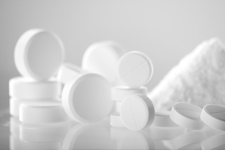 pills bottle: white pills closeup  Stock Photo
