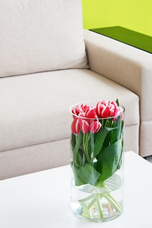 vase of tulips on table  photo