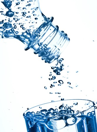 slight: bottle in pure water with waves and bubbles  Stock Photo