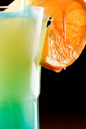 Summer drink decorated with a slice of orange  photo