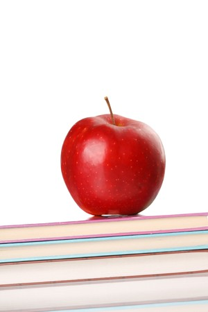 red apple on a book isolated on white Stock Photo - 7044900
