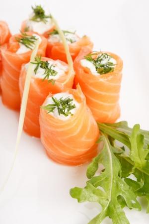 Smoked salmon rolls with cream cheese photo