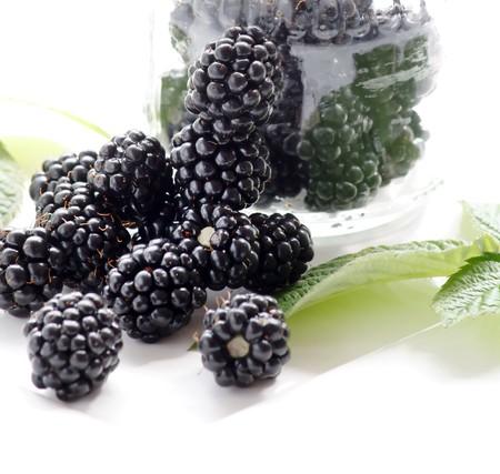 dewberries (blackberries) and green leaves  Stock Photo - 7207111