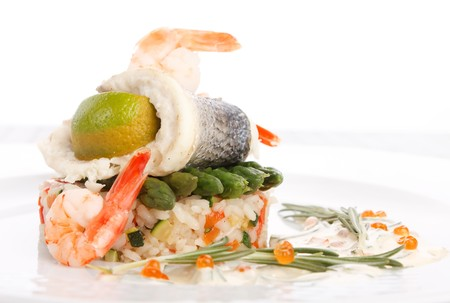 prepared fish with rice and vegetables photo