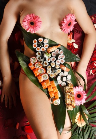 model fish: sushi in the woman in the restaurant
