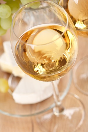 white wine glass: Still-life with bunch of grapes and white wine  Stock Photo