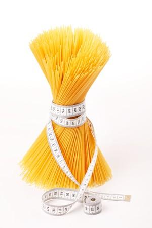 Spaghetti with measuring tape  photo