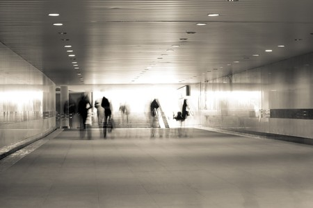 motion blurred of people walking in subway  photo