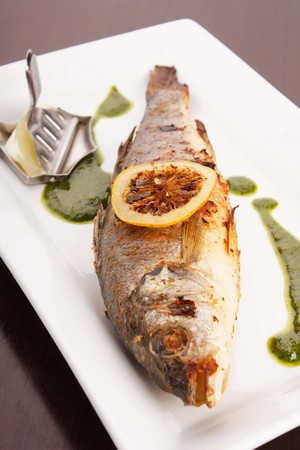 Sea Bream fish with spinach sauce  photo