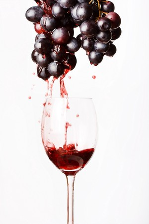 abstract liquor: red wine and grapes  Stock Photo