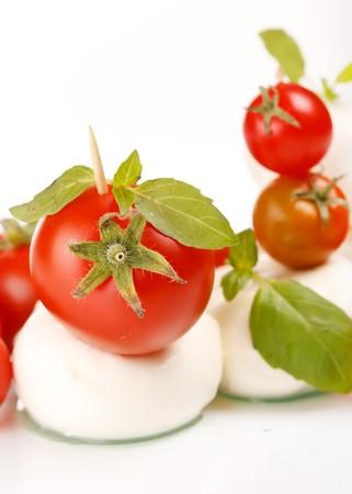 caprese: tomatoes with mozzarella and basil  Stock Photo