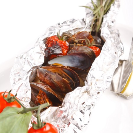 fish in the foil with mussels photo