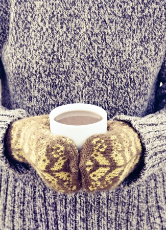mitten: hot chocolate in the hands