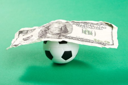 football and dollars  Stock Photo - 8182826