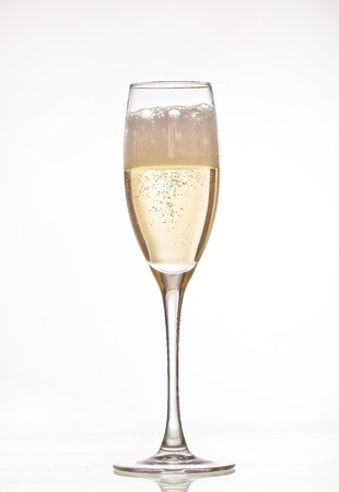 gold flute: A glass of champagne