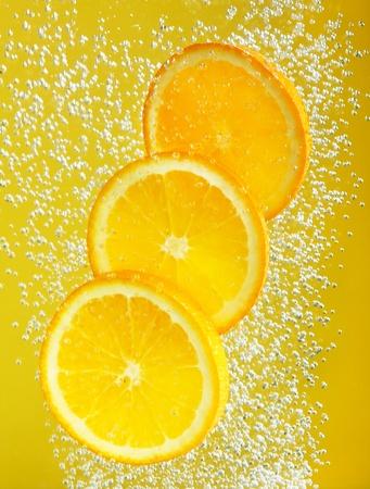 fallin: Fresh orange dropped into water