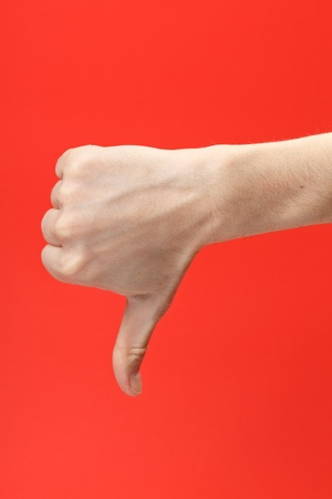 disapproving: Disapproving gesture of a hand on red background