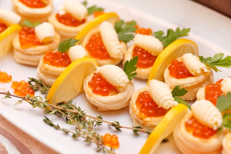 Canapes with red caviar and lemon  photo
