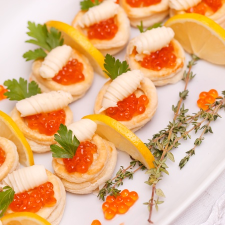Canapes with red caviar and lemon  Stock Photo - 8640857