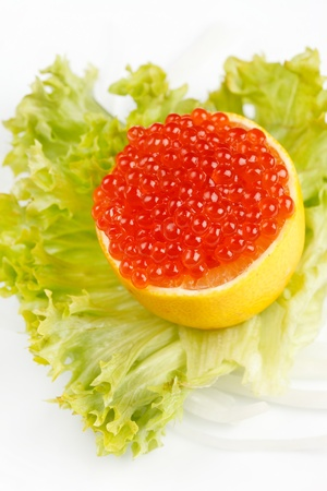 Caviar served on fresh lemon Stock Photo - 8717019