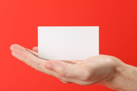 businessmans hand holding blank white paper business card photo