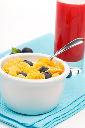 bowl of cornflakes with milk and blueberries  photo